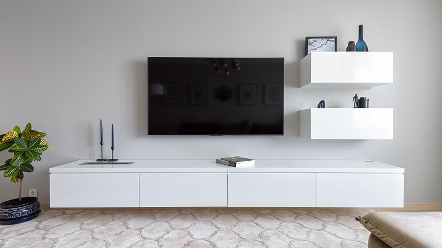 minimalistic hall with tv mounted against white wall