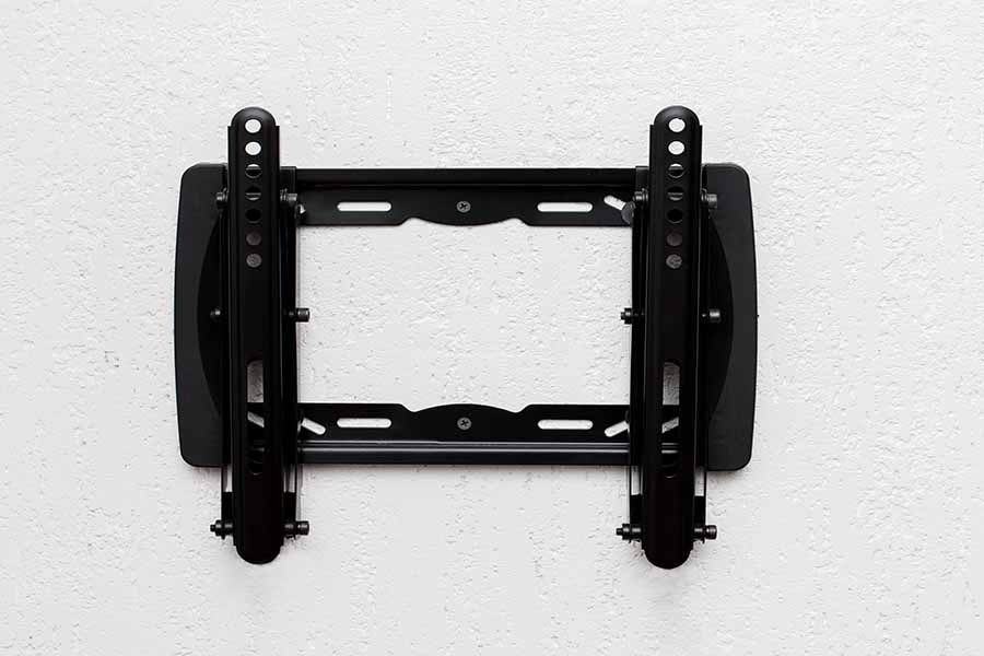 simple tv mount installation against white wall