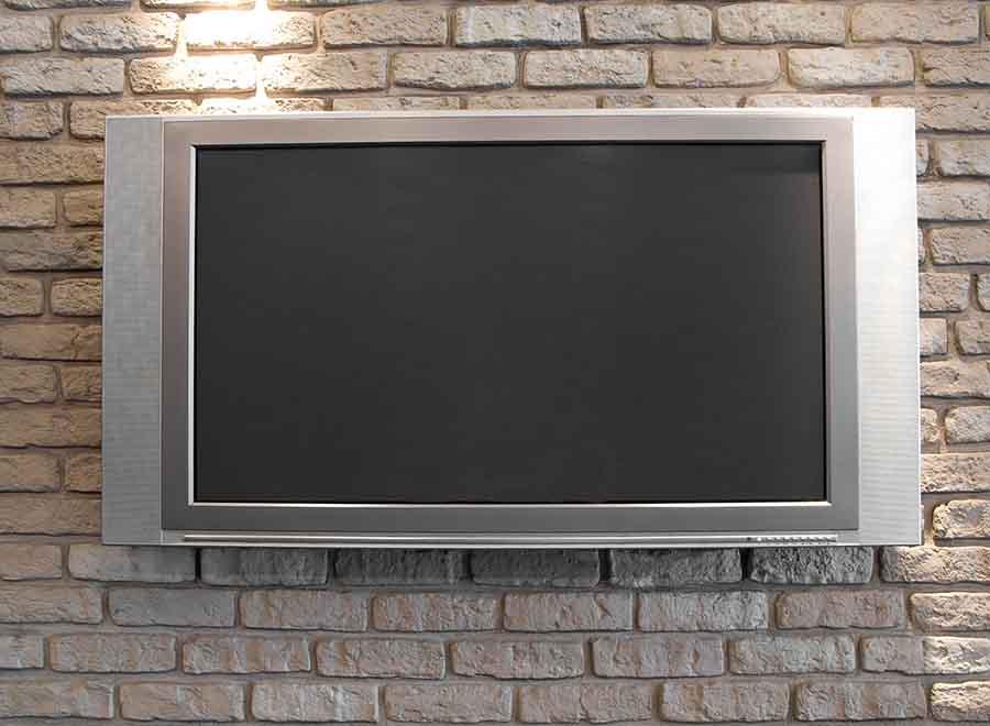 TV mounted on brick wall using TV installation service