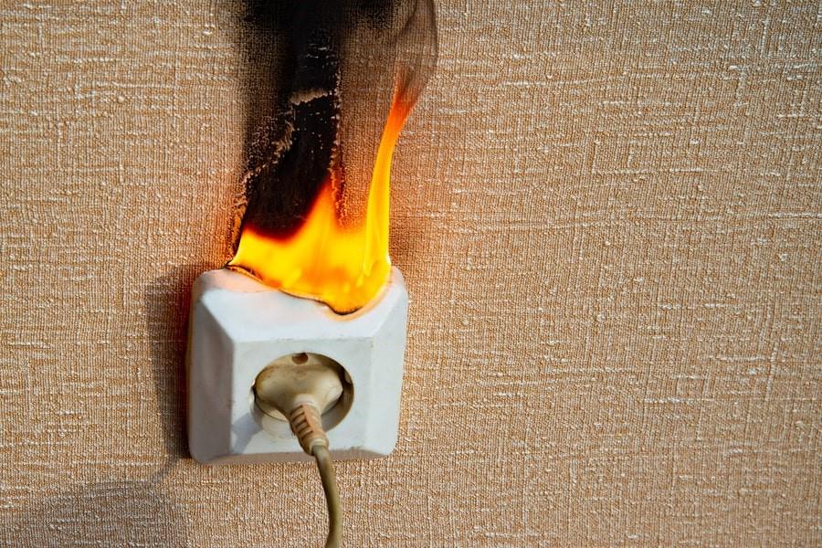 electrical emergency power socket on fire