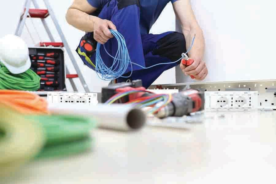 an emergency electrical service personal helping with electrical wiring installation